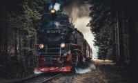 A heavy train through a light thunder storm.
