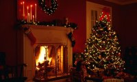 Reading a book in front of the fireplace while a Christmas party is happening around you