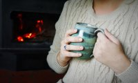 Crackling fire, rain against the window, and a purring cat as you drink your tea