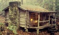 Log cabin in the rain