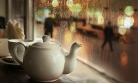 At a rainy, cozy café.