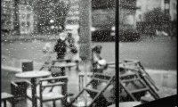 Casual atmosphere of a café while it rains lightly outside