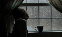 Watching the Rain Through a Window