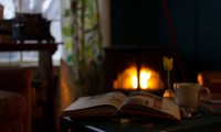 By the fireplace on a rainy day