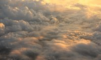 Over the clouds, the wings soar through soft winds...