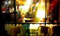 a coffee shop on a rainy night
