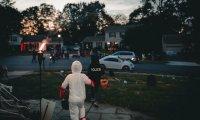 Maddie walks through the neighbourhood on Halloween