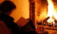 Reading by a cozy fire