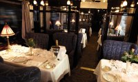 Taking a meal aboard a luxurious steam train