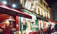 Busy street café on rainy day