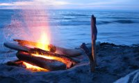 Fire on a rocky beach