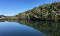 sitting on the bridge at Melton Lake