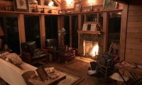 Sleep or relax to the sound of a crackling fire, rain, distant thunder, and a gentle piano