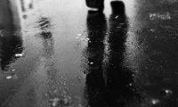 Walking In The Rain (With Umbrella)