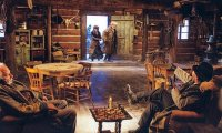 Sharing a wooden cabin during a blizzard with fellow travellers.