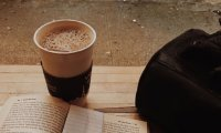 Reading in a New York City Cafe as it Rains Outside