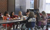 Children eating and chatting