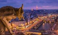 Running across Parisian rooftops, possibly on patrol