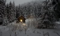 Winter Cabin at Night During a Storm