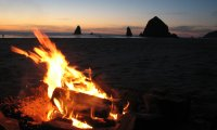 Relax by a bonfire on a beach in Oregon