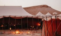 in your tent while dusk falls on the oasis
