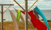 Hanging laundry on the line while watching your newborn