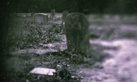 A graveyard, with distant bells and soft wind.