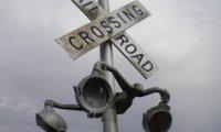 Train crossing in the rain