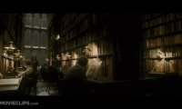 Studying through a snowstorm in the warm and cozy Hogwarts library