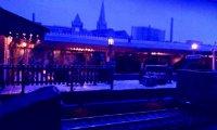 Urban 1940s Steam Railway Station after dark