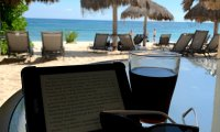 Sitting on a beachside porch in Akumal, Mexico