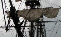 tall ship at anchor, foggy day