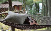 Playing the Ukulele while swinging in a hammock