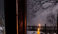 Inside an old wooden house in a snowstorm