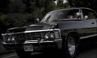 Humming Dean to sleep in the Impala