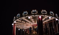 Carnival with carousel and barker, horses and city sounds
