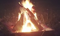 Campfire in meadow