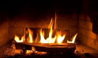 By the fireplace, during a storm