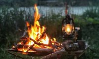 relaxing at campfire with music