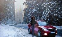 Riding in a car down a snowy road.