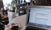 writing in a cozy coffee shop