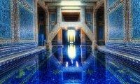 An quiet, echoing, indoor pool.