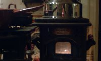 Cooking oil stove with kettle