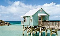 A quiet house by the seashore on a clear, sunny morning
