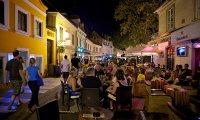 A city street on a summer night